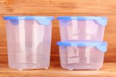 image of tupperware  - Plastic containers for food on wooden background - JPG