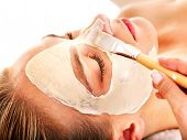 stock photo of female mask  - Woman with clay facial mask in beauty spa - JPG
