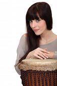 picture of bongo  - Woman posing with bongo drum - JPG
