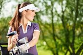 stock photo of golf bag  - Gorgeous golfer lady with golf equipment - JPG