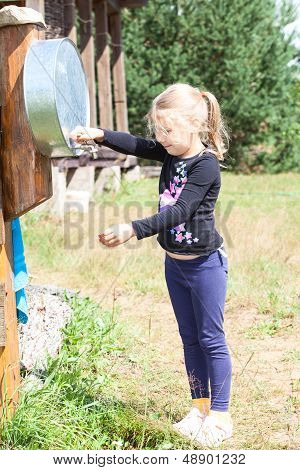 Blond Hair Girl Standing With Washstand In Summer, Outdoor
