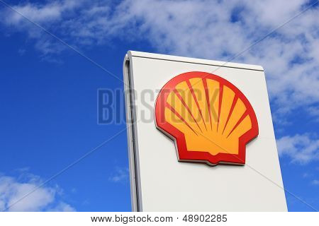 Sign Shell Against Blue Sky