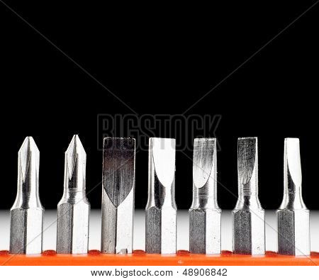 Screwdriver heads on black and white background