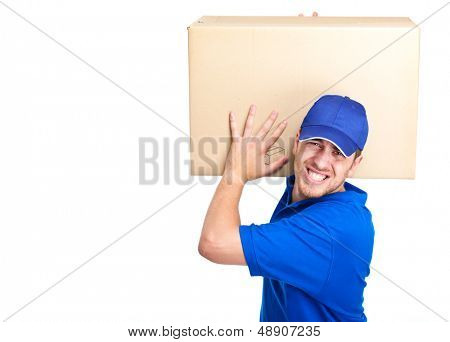 Young delivery boy holding a heavy box