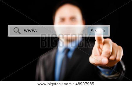 Man clicking a search button