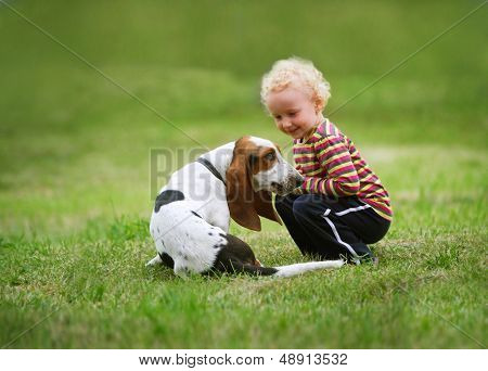 Little Girl Playing With A Dog