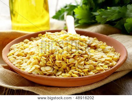 yellow lentils in a bowl on the table