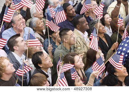 High angle view of happy multi ethnic people holding American flag