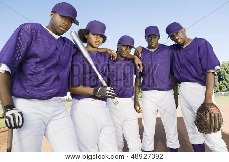 Portrait of a group of African American baseball team mates