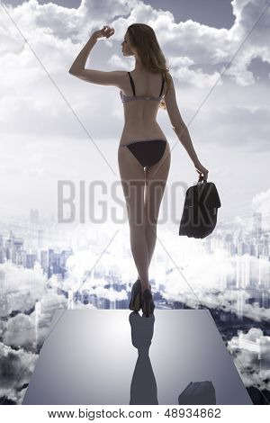 Girl With Bikini And Business Bag In Drammatic Light