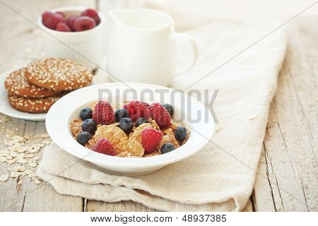 Rasberry and milk on wooden background