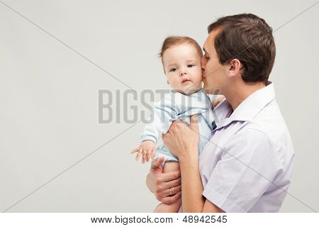 Father with his baby son, studio photo
