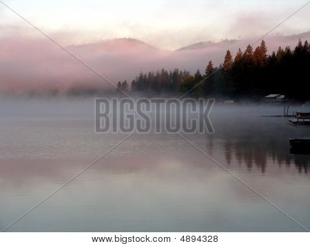 Misty Lake At Sunrise