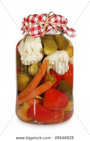 Mixed pickled vegetables in glass jar
