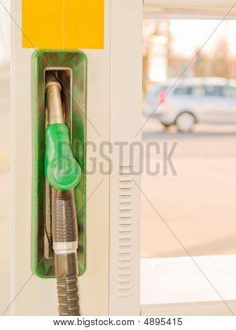 Service Station - Fuel Nozzle With Car In Background