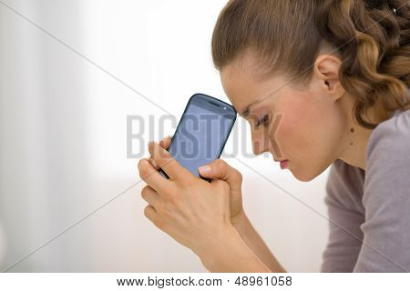 Portrait Of Stressed Young Woman With Cell Phone