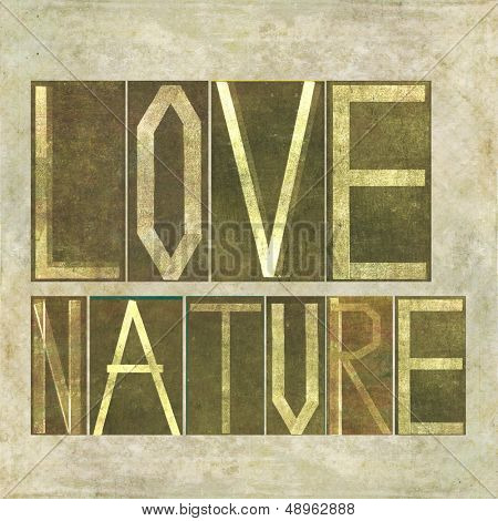 "Earthy textured background image and design element depicting the words ""Love Nature"""