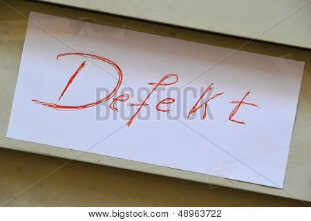 handwritten sign with the word defect