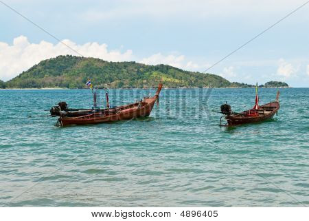 Two Wooden Boats At The Sea