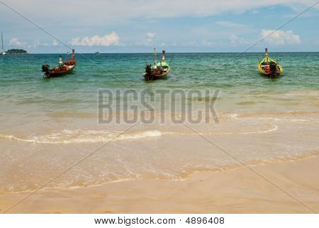 Three Wooden Boats At The Sea