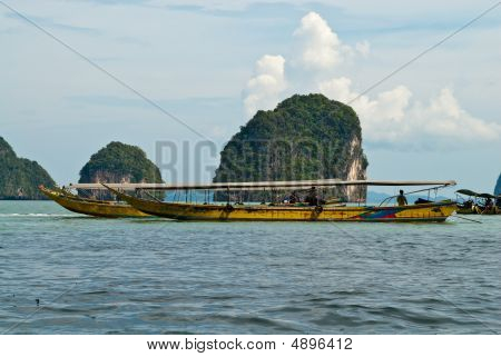 Traditional Thai Tourist Wooden Boats At The Sea