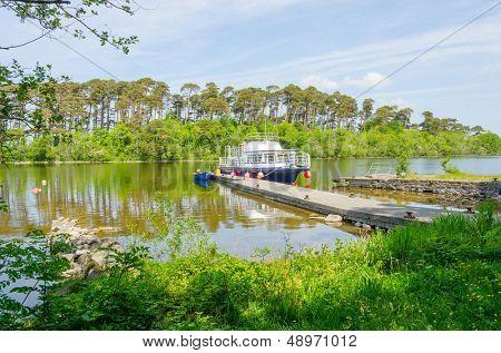CONG, IRELAND - JUNE 06: cruise boat  Corrib Queen moor in port on Inchagoill Island on Lake Corrib, Cong, Ireland on June 06, 2013