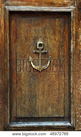 Anchor On Old Wooden Door