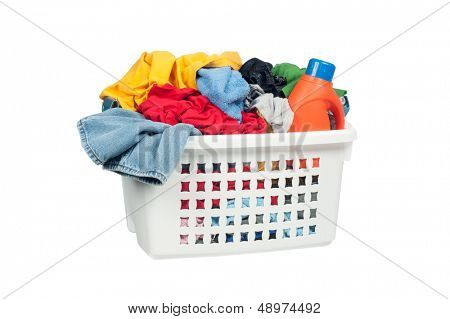 White laundry basket full of colorful clothing and a bottle of cleaning detergent.