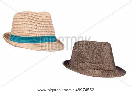 Two isolated fedora sunhats for use as retro revival clothing objects or any other head wear inferences.