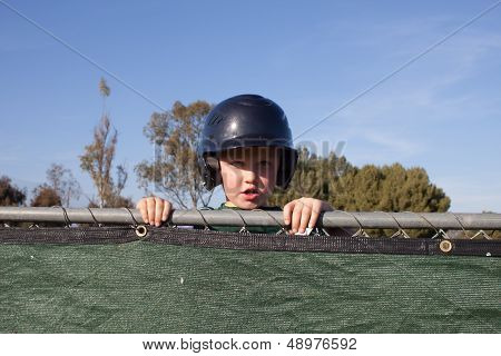 Baseball Player Peeking Over the Dug Out