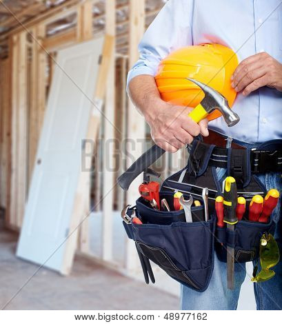 Worker with a tool belt. Construction industry.