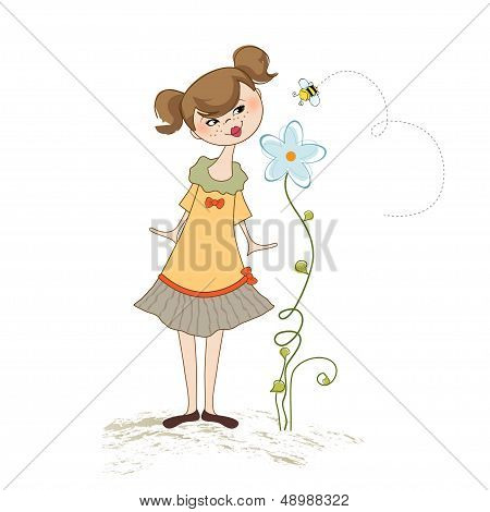 Small Young Lady Who Smells A Flower