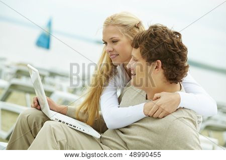 Happy dates with laptop spending time together