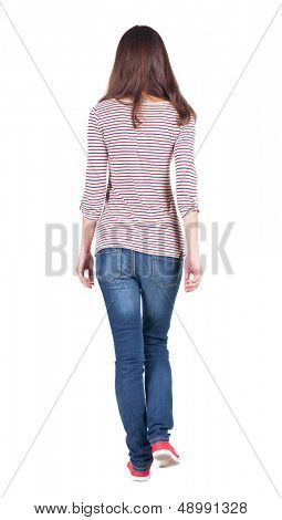 back view of walking  woman in jeans .  backside view of person.  Rear view people collection. Isolated over white background. The girl in a striped T-shirt with sleeves podkatannymi goes ahead