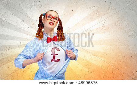 Young woman acting like super hero with pound sign on chest
