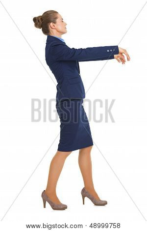 Full Length Portrait Of Business Woman Walking Like Zombie