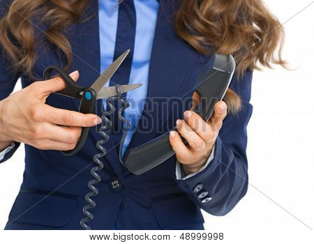 Closeup On Business Woman Cutting Phone Wire