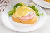 image of benediction  - Eggs benedict close up on white plate serving table - JPG