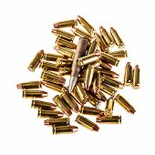 stock photo of 9mm  - a heap of 9mm pistol bullets isolated over a white background - JPG