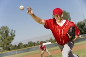 image of ball cap  - Baseball pitcher throwing a ball - JPG
