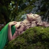 stock photo of fairies  - Portrait of elegant woman with luxurious hair in a coniferous forest - JPG