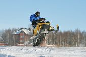 stock photo of ski-doo  - Snowmobile racing in Surgut There is High long jump - JPG