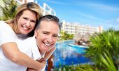 stock photo of caribbean  - Happy senior couple at tropical resort - JPG