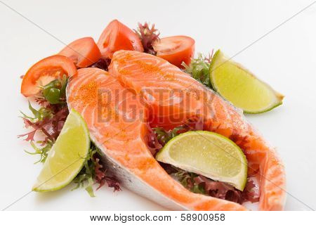 Raw Salmon Fillet With Vegetables On White Background