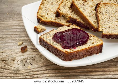 healthy breakfast concept - slices of freshly baked, gluten free bread made with almond and coconut flour and flaxseed meal, with home made, sugar free, cranberry sauce