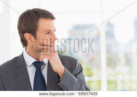 Close-up of a handsome young businessman over blurred background outdoors