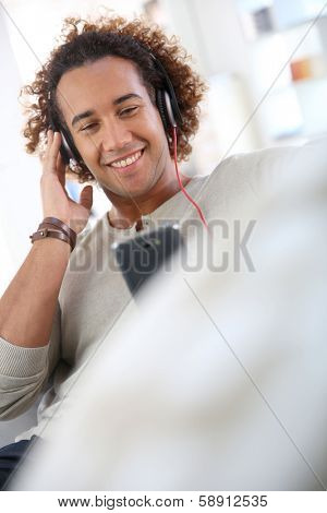 Cheerful attractive man listening to music