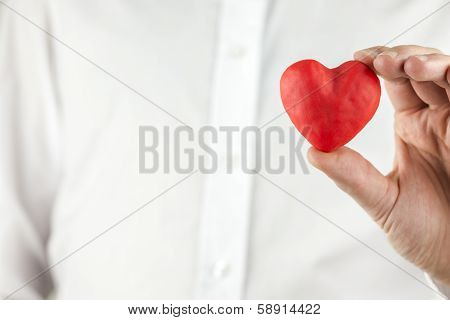 Man Holding A Romantic Red Heart