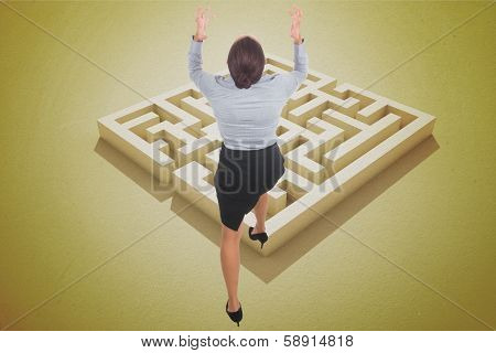 Businesswoman gesturing against yellow puzzle