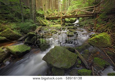 Brook With A Wooden Bridge